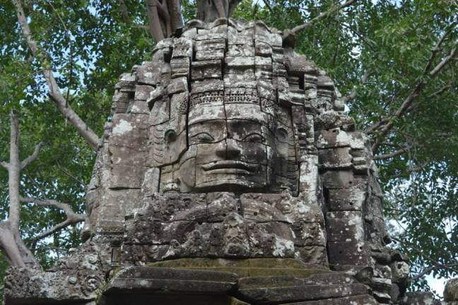Facing up to one of the smaller temples at Angkor.